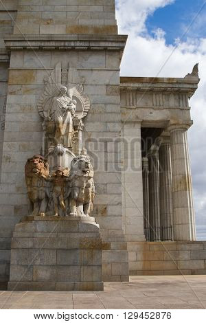MELBOURNE, AUSTRALIA - APRIL, 2016 : The buttress sculptures of woman on a chariot, a pair of lions with a child standing in between at Shrine of Remembrance, in Melbourne, Australia on April 10, 2016