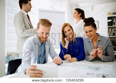Business people taking a selfie of themselves in office