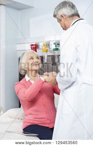 Doctor Holding Patient's Hand In Rehab Center