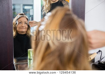 Mature Woman Having Hair Dyed At Beauty Parlor