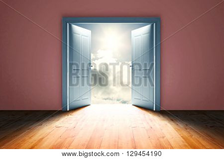 Door opening in dark room to show sky against blue sky with clouds and sun