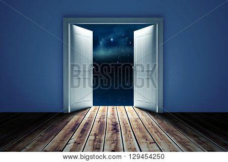 Door opening in dark room to show sky against stars twinkling in night sky