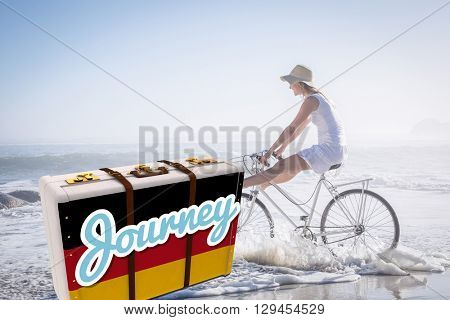 Suitcase with the German flag against woman riding bike