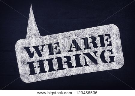 We are hiring message against navy blue