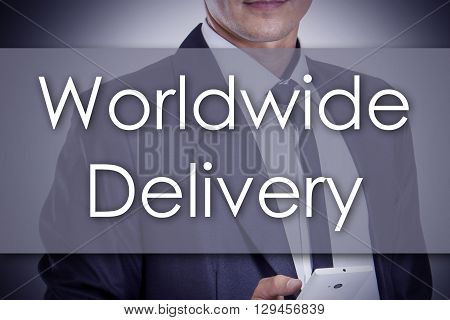 Worldwide Delivery - Young Businessman With Text - Business Concept