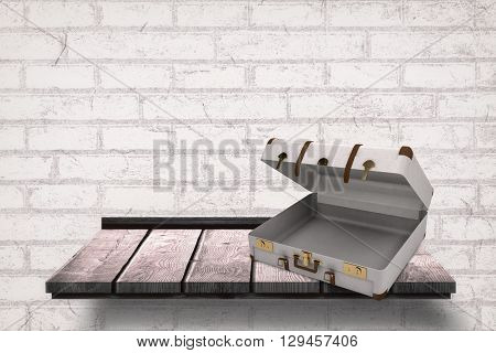 Open suitcase against wooden board