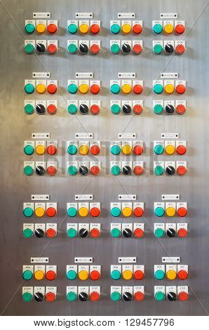 Industrial electric switch panel with buttons in different colours.
