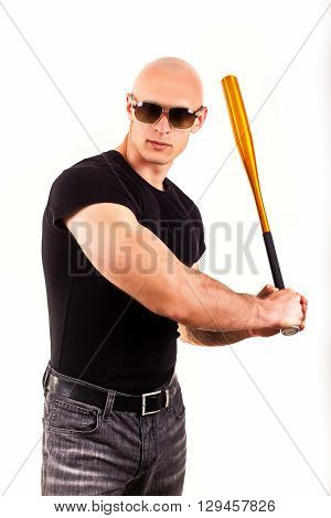 Violence and aggression concept - furious screaming angry man hand holding baseball sport bat in black t-shirt