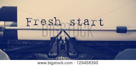 Words fresh start against white background against close-up of typewriter