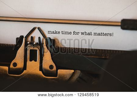 The word make time for what matters! against close-up of typewriter