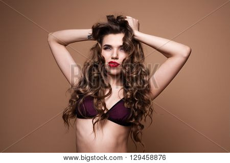 Attractive young girl posing in the studio. Pensively looks aside