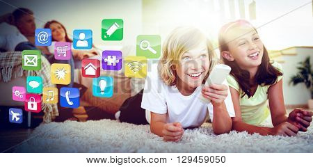 Colourful computer applications against siblings lying on the floor watching tv