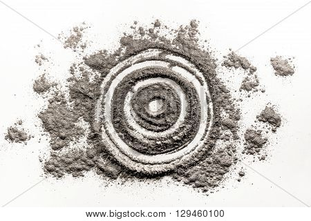 Bullseye target round circle shape drawing in grey dust ash dirt sand