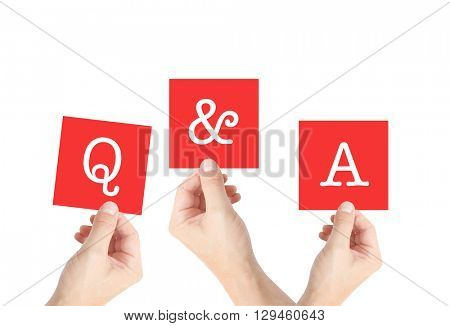 Q and A written on cards held by hands