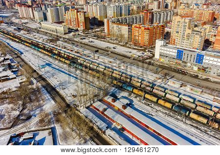 Tyumen, Russia - March 9, 2016: The railroad along 50 let VLKSM Street, dividing old and new districts of the city