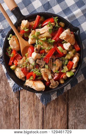 Stir Fry Chicken With Mushrooms, Peppers And Zucchini On A Pan Close-up. Vertical Top View