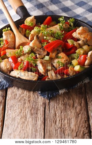 Chicken Saute With Mushrooms, Peppers And Zucchini On A Frying Pan. Vertical