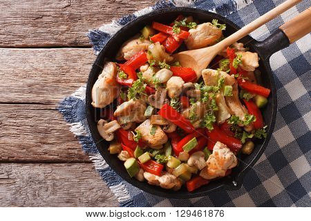 Stir Fry Chicken With Mushrooms, Peppers And Zucchini On A Pan Close-up. Horizontal Top View