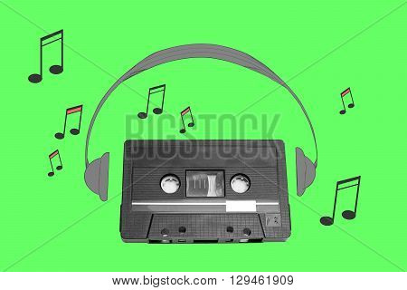 Audiotape and headphone draw on green background