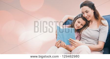 Background of multiple color against mother and daughter reading a book