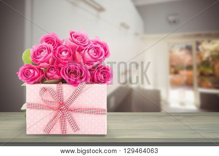 Gifts in a white background against a shelves in a house