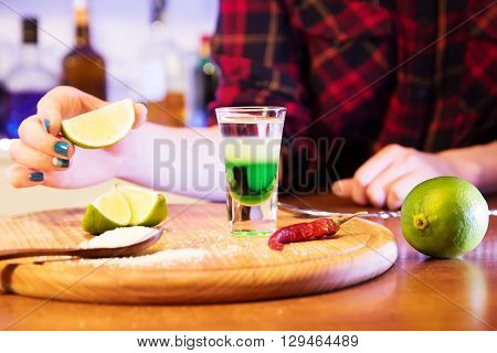 alcoholic drinks shot on a wooden board with fruit