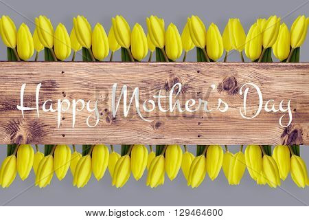 Sentence against wooden planks background for mothers day