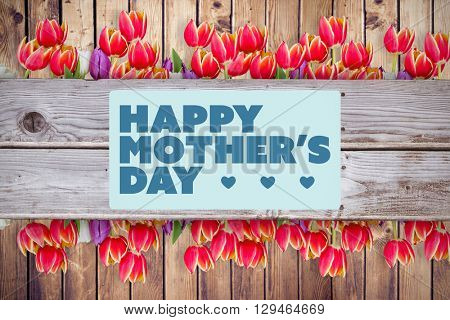 Mothers day greeting against wooden planks