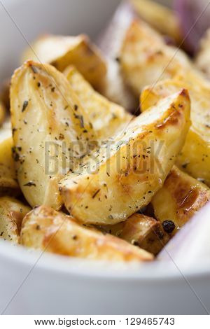 White grilled sausages with sauerkraut or cabbage, black pepper and fresh cold beer in a bowl on an old vintage wooden background, closeup