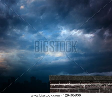 Red brick wall against gloomy sky