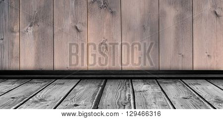 Image of a wall against wooden planks