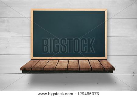 Image of a board against bleached wooden planks background