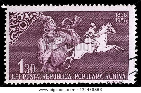 ZAGREB, CROATIA - JULY 19: a stamp printed in Romania shows Post horn blowing postman and postrider, 100 Years of Romanian Stamps issue, circa 1958, on July19, 2014, Zagreb, Croatia