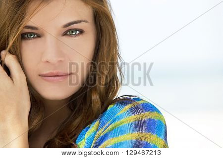 Portrait of a beautiful brunette young woman with stunning green eyes, shot outside in natural light