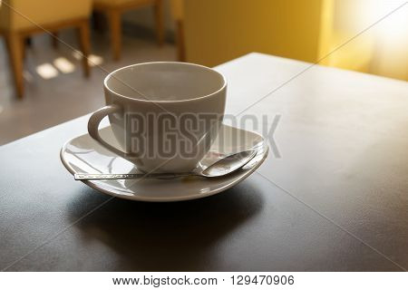 coffee cup in coffee shop. Morning light
