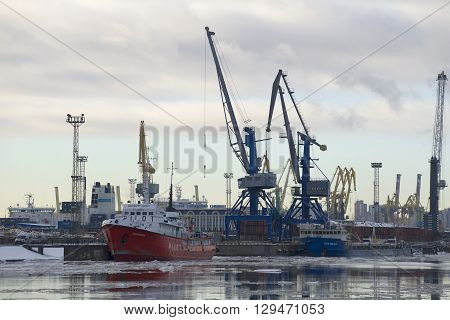 SAINT PETERSBURG, RUSSIA - FEBRUARY 17, 2016: Cloud february morning at the St. Petersburg cargo port. Cargo barges are unloaded at the port. The largest port city of St. Petersburg