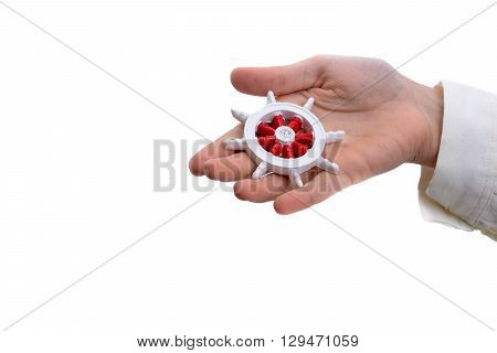 Isolated red and white color Ship steering wheel onhand