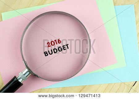 Word 2016 Budget On Colored Paper With Magnifying Glass.