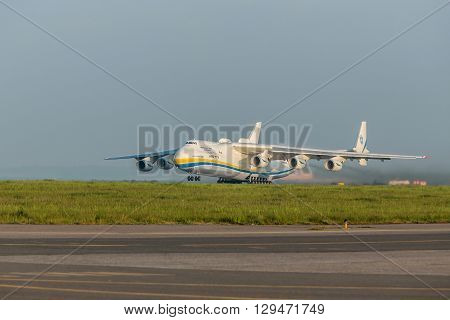 PRAGUE CZE - MAY 12: Antonov 225 Mriya airplane departs from runway on Airport Vaclava Havla in Prague May 12 2016 PRAGUE CZECH REPUBLIC. The biggest airplane in the world.