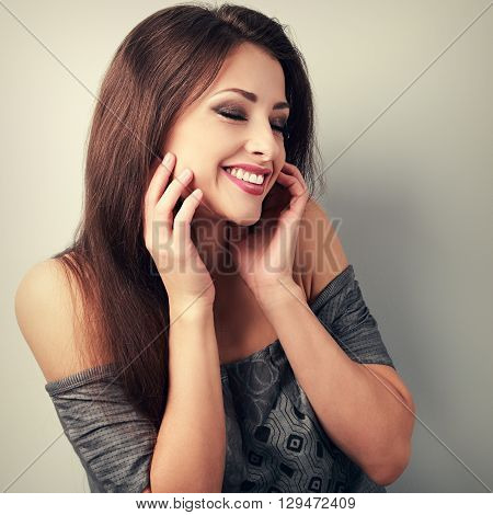 Happy Laughing Brunette Young Woman Holding The Hand At Face And Giggling. Vintage Toned Portrait