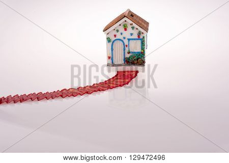 House with a red ribbon on a white background