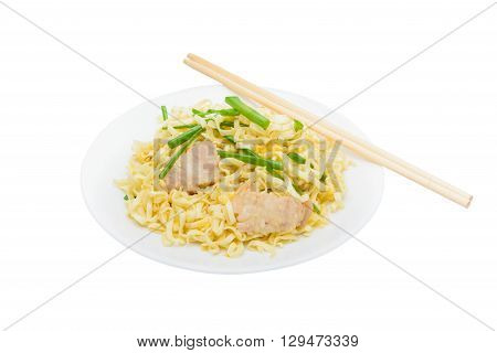 Pork chow mein with chopsticks in white plate. isolated on white background with clipping path