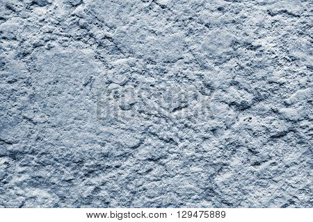bumpy texture of a concrete or stone surface of silvery color for abstract background and for wallpaper