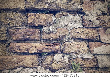 ancient texture of an old brick wall for wallpaper and for a background in retro style