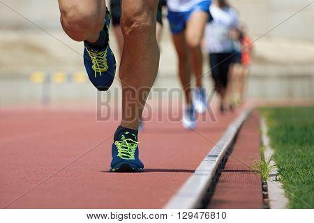Marathon runners.Marathon with the aim of the stadium,running on the athletics track