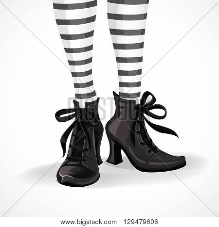 Halloween closeup witch legs in striped stockings and black boots isolated on a white background