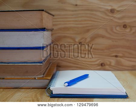 old book  and notebooks Placed on a wooden floor. (View with copy space)