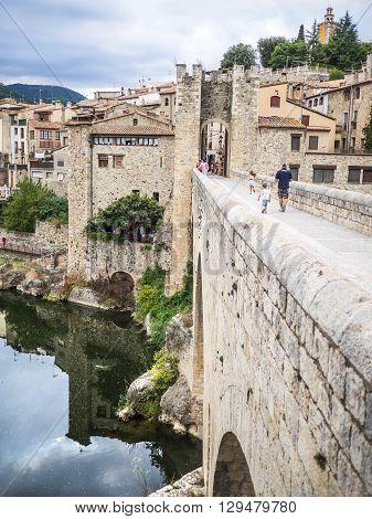 Besalu Spain - August 16 2014 - Crossing the bridge to Besalu