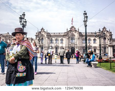 Lima Peru - October 11 2014 - A Peruvian woman selling sweets in the Plaza de Armas square in Lima Peru.