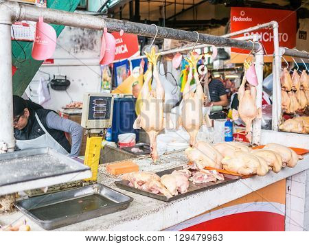 Lima Peru - October 13 2014 - A little store selling chicken in the Mercado de Surquillo in Lima (Peru)